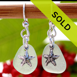 A TOP quality pair of Seafoam Green Genuine Certified Sea Glass earrings With Starfish Charms Sorry this pair has been sold!