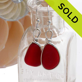 A stunning pair of natural GENUINE red sea glass earrings set in sterling silver. Sorry this Sea Glass Jewelry selection has been SOLD!