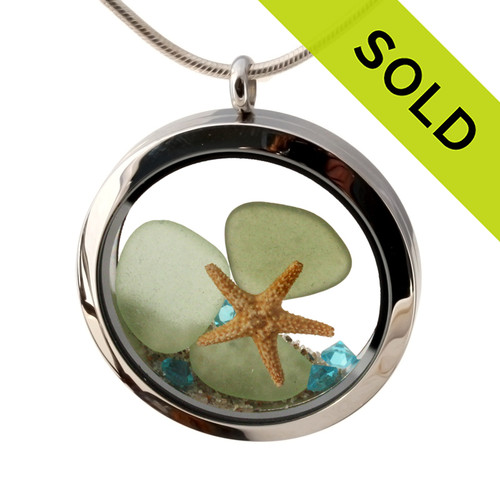 Beautiful pieces of seafoam and olive green sea glass pieces combined with a real starfish. Finished with real beach sand  and aquamarine gems in this JUMBO 35MM stainless steel locket. SOLD - Sorry this Sea Glass Locket is NO LONGER AVAILABLE!