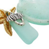 An nice piece of Vivid Aqua sea glass on a professionally hand cast solid sterling bail combined with a solid sterling Palm Tree charm.