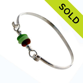 Three pieces of beach found sea glass on a solid sterling half round bangle bracelet. SOLD - Sorry this Sea Glass Bracelet is NO LONGER AVAILABLE!