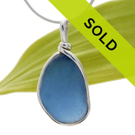 A very nice piece of Medium Blue with in our signature Original Wire Bezel© necklace pendant setting that leaves both front and back open and the glass unaltered. Sorry this sea glass jewelry selection has been sold!