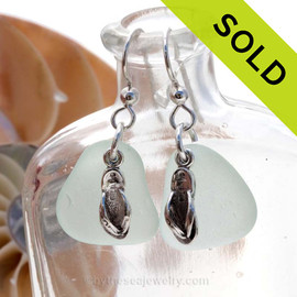 Natural medium large seafoam green sea glass earrings are set with solid sterling flip flop charms and are presented on sterling silver fishook earrings. Sorry this Sea Glass Jewelry selection is NO LONGER AVAILABLE!