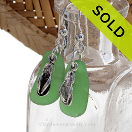 A simple pair of genuine green sea glass earrings with flip flop charms in a lightweight simple setting. Sorry this Sea Glass Jewelry selection has been SOLD!