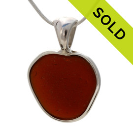 A beautiful Chocolate Brown natural sea glass heart set in our deluxe wire bezel pendant setting!  Genuine sea glass hearts are a RARE phenomena and cherished among sea glass lovers!