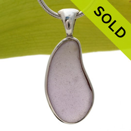 A PERFECT piece of lavender or purple sea glass from Maine set in our Solid Sterling Silver Deluxe Wire Bezel pendant setting. SOLD - Sorry this Rare Sea Glass Pendant is NO LONGER AVAILABLE!