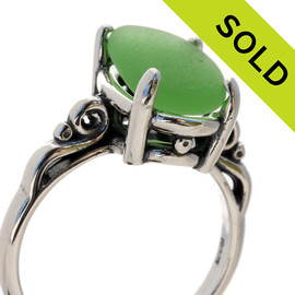 A natural UNALTERED pure bright green sea glass piece set in a sterling silver scroll ring. The sea glass is loosely set but will be fully set upon arrival. SOLD - Sorry this Sea Glass Ring is NO LONGER AVAILABLE!