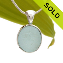 A wonderful shaped thick piece of vivid baby Blue sea glass in our In Our Deluxe Sterling Wire Bezel© necklace pendant.