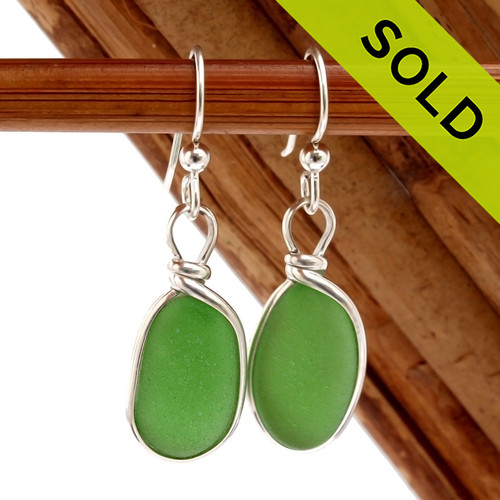 Genuine beach found Bright Mermaids Emerald Green Sea Glass Earrings in a Solid Sterling Silver Original Wire Bezel© setting. Sorry this Sea Glass Jewelry selection has been SOLD