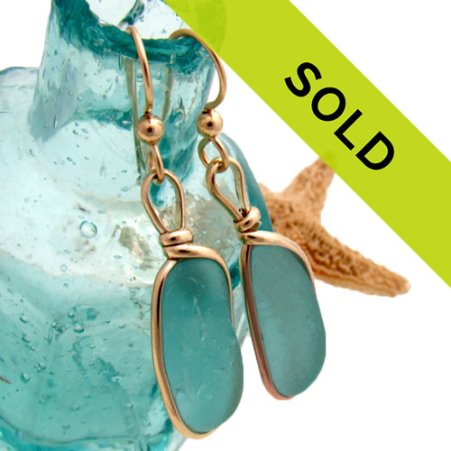 Gorgeous vivid aqua blue sea glass earrings in gold bezel.