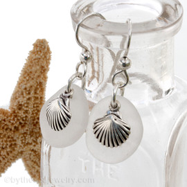 Beach found white sea glass pieces with solid sterling sea shell charms. A great pair of sea glass earrings for any time of year!