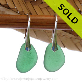 An Unusual bright green sea glass pieces really on solid sterling silver leverbacks.  Sorry this sea glass jewelry selection has been sold!