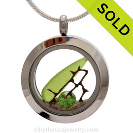 Genuine lime green and cobalt blue sea glass piece combined with a bit of vintage sea fan and a real beach sand in this stainless steel locket. Finished witha  vivid peridot crystal gem for a bit of beachy bling. SOLD - Sorry this Sea Glass Locket is NO LONGER AVAILABLE!