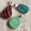 The trio of custom sea glass pendants.