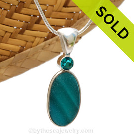 This beautiful HIGHLY RARE Seaham sea glass piece is set in our Deluxe Wire Bezel© pendant setting. This incorporates a Paraiba gem in a tube bezel setting for a touch of elegance. Sorry this Ultra Rare Sea Glass Jewelry piece has been sold!