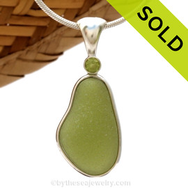 This beautiful Bright Peridot Green sea glass piece is set in our Deluxe Wire Bezel© pendant setting with a genuine Peridot gem. SOLD - Sorry this Rare Sea Glass Pendant is NO LONGER AVAILABLE!