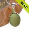 This beautiful Bright Peridot Green sea glass gem ball piece is set in our Deluxe Wire Bezel© pendant setting with a genuine Peridot gem. SOLD - Sorry this Rare Sea Glass Pendant is NO LONGER AVAILABLE!