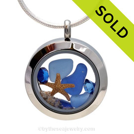 Genuine sea glass in cobalt blue and the lighter Carolina Blue, a real baby starfish in this mini sea glass locket necklace. Sapphire Gems bring in a bit of beachy bling to the piece. SOLD, sorry this sea glass jewelry piece is no longer available.