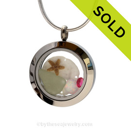 Pale Sea Green Sea Glass combined with a real starfish and sandollar and brightened up a pink tourmaline gem an Opal and Tourmaline comes in many shades but pink is the most desirable.  SOLD - sorry this Sea Glass Jewelry selection is no longer available.