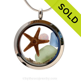 Seafoam and light blue sea glass combined with a real starfish and finished with a simulated opal for that October Sea Glass Lover. Sorry this Sea Glass Jewelry selection has been sold!