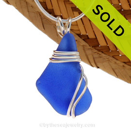 A vivid LARGE and perfect rich cobalt blue Sea Glass In Deluxe Sterling Triple Wire Necklace Pendant. This setting leaves the sea glass piece UNALTERED but secure in an attractive setting. Sorry this piece of Sea Glass Jewelry has been sold!
