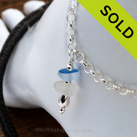 Simple sea glass ankle bracelet in silver with mixed English Flashed Blue and a piece of pure white. Sorry this Sea Glass Jewelry selection has been SOLD!
