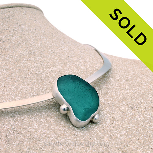 A lovely fine set vivid aqua sea glass in sterling silver