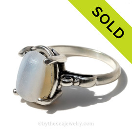 A natural UNALTERED and Ultra Rare Opalized sea glass piece set in a sterling silver scroll ring. Sorry this Ultra Rare Sea Glass Ring has been SOLD!