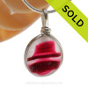 A vivid mix of hot pink in a base of pure white endoday sea glass from England set in our Original Wire Bezel© necklace pendant setting.