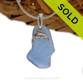 A nice piece of Carolina Blue Certified Genuine Sea Glass in a Sterling Necklace with a Dolphin Charm Sorry this Sea Glass Jewelry piece has been SOLD!