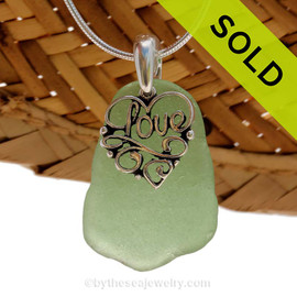 "A nice larger piece of green genuine sea glass necklace with a solid sterling bail and detailed ""Love"" heart charm. Sorry this Sea Glass Jewelry selection has been SOLD!"