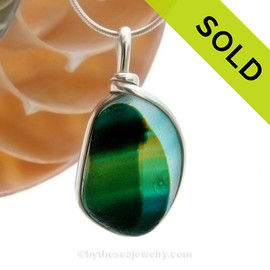 A beautiful piece of 4 color multi  teal green  with gold sea glass set for a necklace in our Original Sea Glass Bezel© in solid sterling silver setting