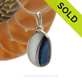 A stunning highly frosted piece of cross sectioned English sea glass that would benefit from a drop of oil on the surface to bring out the colors. Sorry this Sea Glass Pendant has been SOLD!