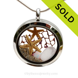 Pale lavender sea glass combined with two baby starfish, sea fan, as simulated opal and beach sand in this twist top stainless steel locket necklace. SOLD - Sorry this Sea Glass Locket is NO LONGER AVAILABLE!