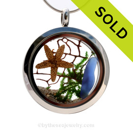 "A beautiful sliver of natural blue sea glass combined in a stainless steel locket necklace a two real starfish and beach sand. A seafan and bit of ""seaweed"" makes this a great choice for any ocean lover! Sorry this Sea Glass Jewelry selection has been SOLD"