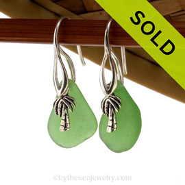 Natural bright green sea glass pieces are set with solid sterling palm tree charms and are presented on sterling silver fishook earrings. SOLD - Sorry these Sea Glass Earrings are NO LONGER AVAILABLE!