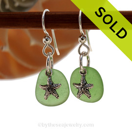 Natural beach found green Sea Glass Earrings are set with solid sterling starfish charms and are presented on sterling silver fishhook earrings. SOLD - sorry this Sea Glass Jewelry selection has already been sold!