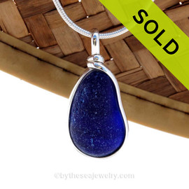 A medium size piece of deep midnight cobalt blue sea glass set in our Original Deluxe Wire Bezel© necklace pendant. SOLD - Sorry this Rare Sea Glass Pendant is NO LONGER AVAILABLE!