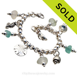Stunning  sea glass from England is the result of art glass scraps being discarded into the North Sea. Solid Sterling charms and a heavy rolo bracelet with soldered utility links ensure this piece will remain with you always! SOLD - Sorry this Sea Glass Charm Bracelet is NO LONGER AVAILABLE!