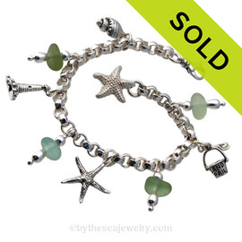 Stunning  sea glass from England is the result of art glass scraps being discarded into the North Sea. Solid Sterling charms and a heavy rolo bracelet with soldered utility links ensure this piece will remain with you always! Sorry this Sea Glass Bracelet is NO LONGER AVAILABLE!