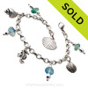 4 pieces of mixed vivid aqua  genuine beach found sea glass combined with solid sterling beach inspired charms in a totally solid sterling silver bracelet. SOLD - Sorry this Sea Glass Charm Bracelet is NO LONGER AVAILABLE!