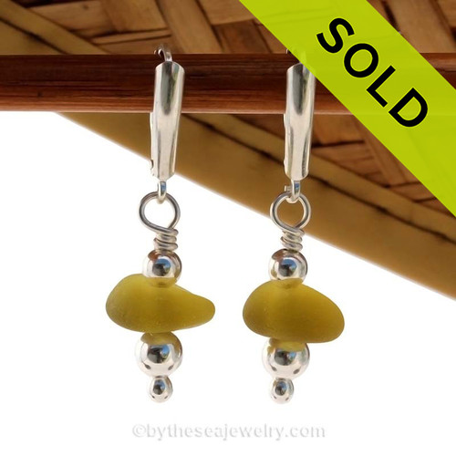 Genuine Citron or Topaz Sea Glass Earrings with sterling details on solid sterling leverback earrings. Sorry this rare pair of sea glass earrings has been SOLD!