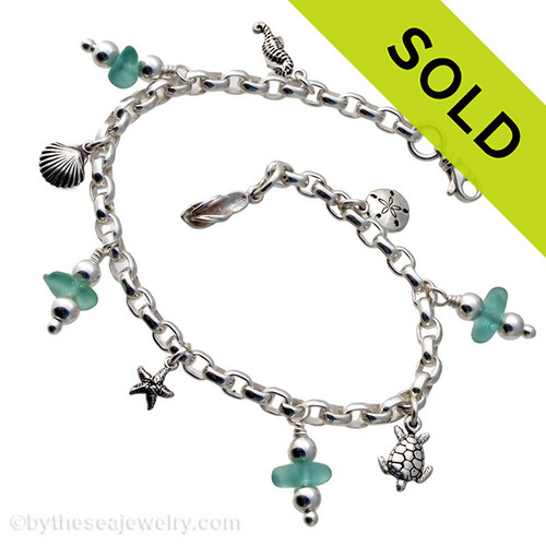 4 pieces of mixed vivid aqua  genuine beach found sea glass combined with solid sterling beach inspired charms in a totally solid sterling silver bracelet. SOLD - Sorry This Sea Glass Bracelet Is NO LONGER AVAILABLE!