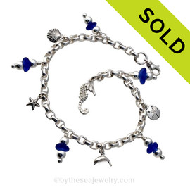 4 pieces of Cobalt Blue genuine beach found sea glass combined with solid sterling beach inspired charms in a totally solid sterling silver bracelet. SOLD - Sorry this Sea Glass Bracelet has been SOLD!