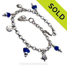 4 pieces of Cobalt Blue genuine beach found sea glass combined with solid sterling beach inspired charms in a totally solid sterling silver bracelet. SOLD - Sorry This Sea Glass Bracelet Is NO LONGER AVAILABLE!