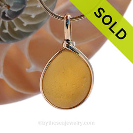 This beautiful Bright Vivid Golden Yellow sea glass pendant is set in our Original Wire Bezel© pendant setting in a 14K Rolled Gold. SOLD - Sorry this Ultra Rare Sea Glass Pendant is NO LONGER AVAILABLE!