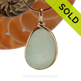 A nice piece of seafoam green with in our signature Original Wire Bezel© pendant setting that leaves both front and back open and the glass unaltered from the way it was found on the beach. Sorry this piece of Sea Glass Jewelry has is NO LONGER AVAILABLE!