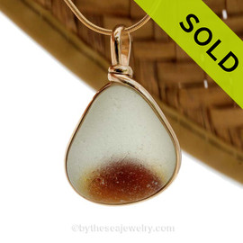 An amazing vivid golden amber in a pure white base. This piece was once the tip of a punty or pontil rod used to gather and work glass in the kiln. The color being worked was the rich amber at the bottom. SOLD - Sorry this Rare Sea Glass Pendant is NO LONGER AVAILABLE!