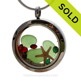 Green Genuine beach found sea glass and a real starfish and beach make this a great locket necklace for the holidays. Ruby and Deep Green crystal gems finish the locket with some extra bling. Sorry this piece of Sea Glass Jewelry has been SOLD!
