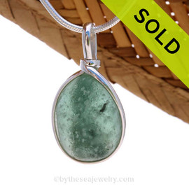 This is done in our Original Wire Bezel© setting that leaves both front and back open for maximum color. Sorry this Ultra Rare Sea Glass Pendant has been SOLD!